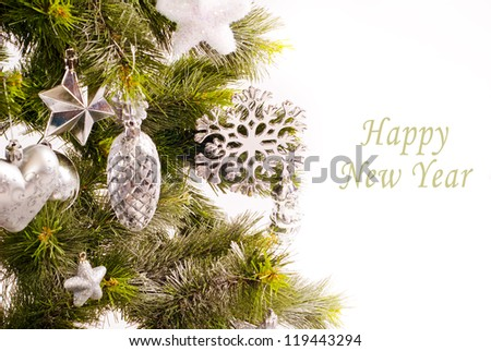 New year card with beautiful decorations on fur tree and place for text - stock photo