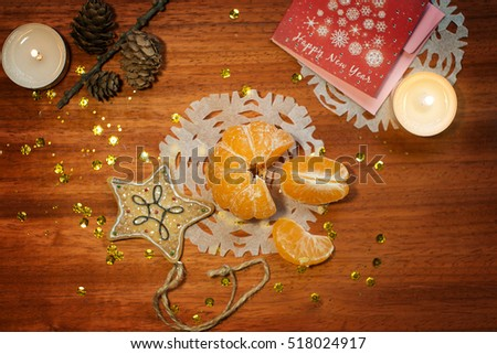 new year card with candles and mandarin