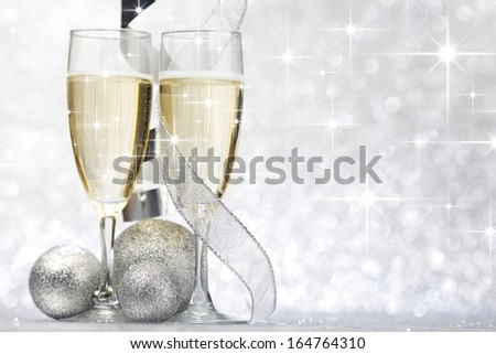 New year card with Champagne and decoration over shiny stars background - stock photo