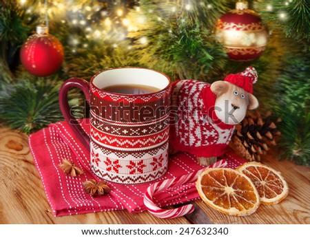 New year card with cup of tea and sheep a symbol of 2015 - stock photo