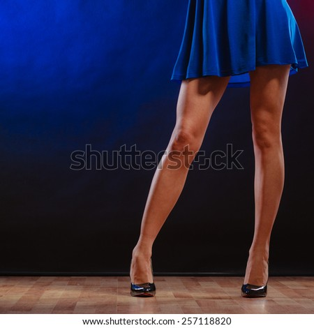 New year, celebration, disco concept - woman in evening dress dancing in the club, part of body female legs in high heels on party floor - stock photo