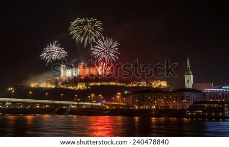 New Year Celebration. Fireworks on the Castle in Bratislava, Slovakia. - stock photo
