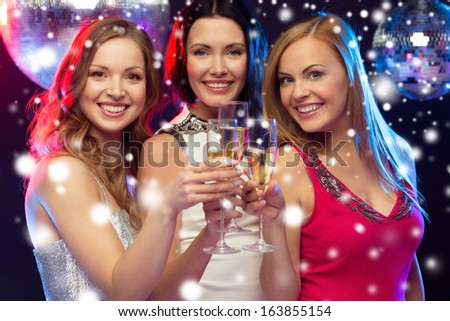 new year, celebration, friends, bachelorette party, birthday concept - three beautiful woman in evening dresses with champagne glasses - stock photo