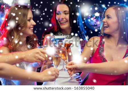 new year, celebration, friends, bachelorette party, birthday concept - three women in evening dresses with cocktails in club or bar - stock photo