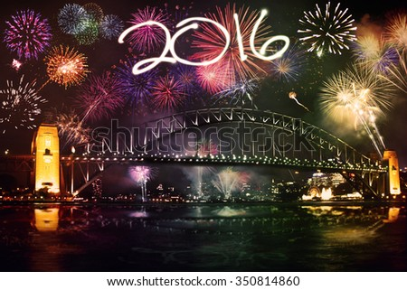 New year celebration with colorful fireworks and numbers 2016 over the Sydney Harbor Bridge - stock photo