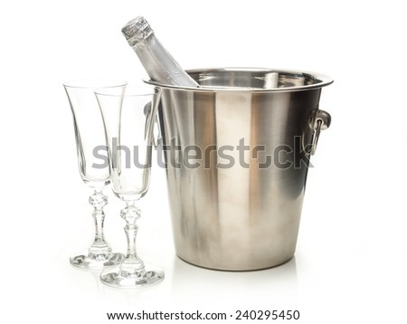 New Year champagne bottle in metal cooler and two champagne glasses shot on white - stock photo