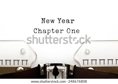 New Year Chapter One printed on an old typewriter. - stock photo
