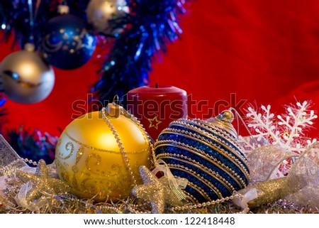 New Year composition with shiny decorative green tree, Christmas tree balls, boxes for gifts and candle. Christmas card from Christmas decorations and candles. Merry Christmas and Happy New Year