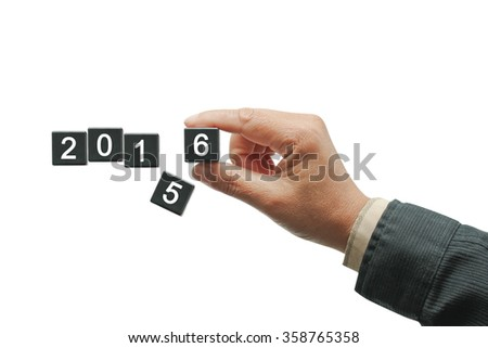 New Year concept, changes number five for number six on 2016 year.