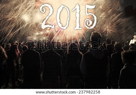 New Year concept - cheering crowd, clock close to midnight and fireworks  - stock photo