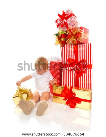 New year 2016 concept child baby toddler kid with Christmas present gifts for celebration isolated on a white background - stock photo