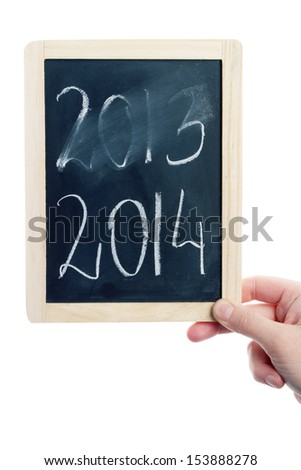 New year concept - hand holding blackboard with 2014 written on it - stock photo