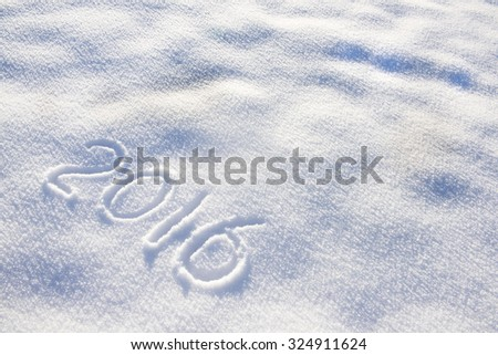 new year date 2016 written in snow - stock photo