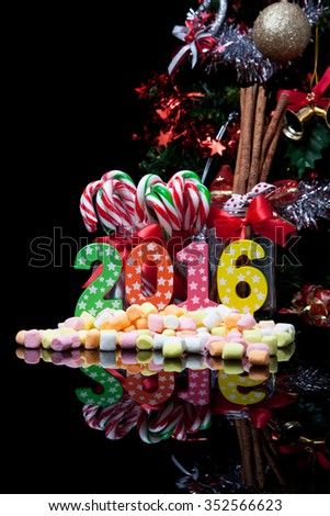 New year decoration with gift box and Christmas tree, on 2016