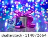 New Year decorations composition with fancy box on bokeh background - stock photo