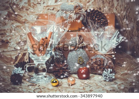 New year decorations. Honey, coffee, cones, cinnamon, box, snow.  toning photo. - stock photo