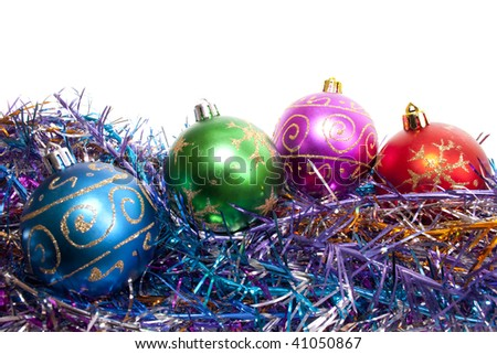 New-year decorations. Varicoloured Christmas balls and tinsel on a white background