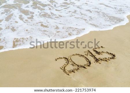new year 2015 digits on  beach sand - stock photo