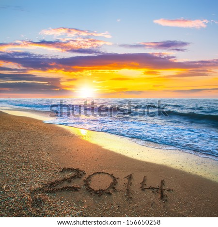 new year 2014 digits on ocean beach sand - stock photo