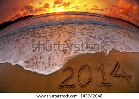 new year 2014 digits on ocean beach sunset - stock photo
