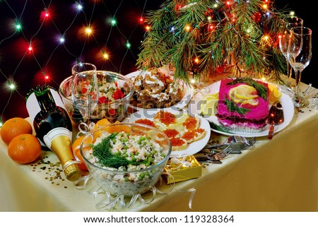New Year dinner in the Russian tradition diagonal view. - stock photo