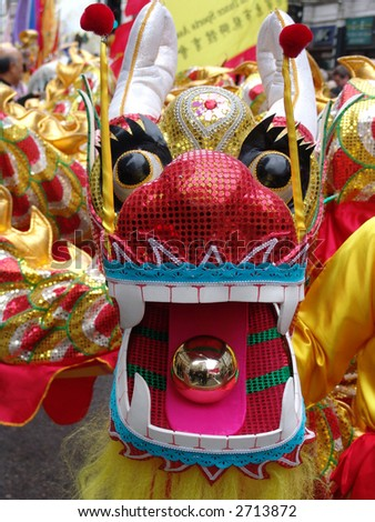New Year dragon dancing at Chinese New Year in Chinatown London - stock photo