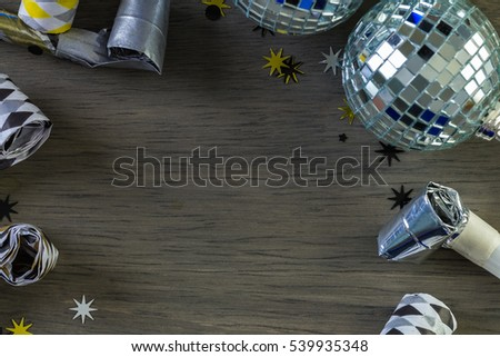 New Year Eve party decorations on gray board.