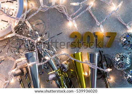 New Year Eve party decorations with year on a silver background.