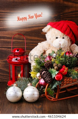 New Year. festive bear with Christmas toys