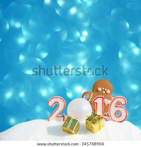 New Year 2016. Figure 2016, Christmas balls, gifts and gingerbread man on blue glitter background - stock photo