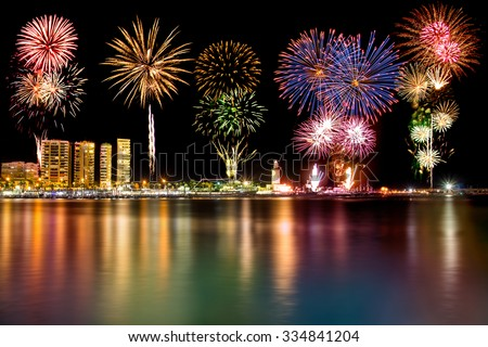 New year firework over lighthouse on the Muelle uno in Malaga city, Spain - stock photo