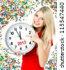 new year 2013. five to twelve. young beautiful woman holding big clock and party decoration - stock photo
