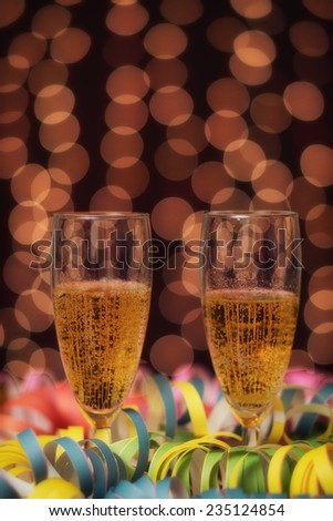 New Year / Glasses full of champagne, lights in the background - stock photo