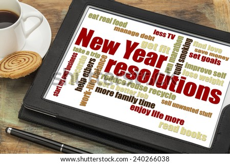 New Year goals or resolutions - a word cloud on a digital tablet with cup of coffee - stock photo