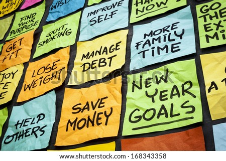 new year goals or resolutions - colorful sticky notes on a blackboard - stock photo
