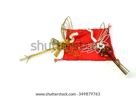 new year gold cranes on the red cushion