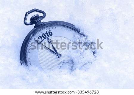 New Year 2016 greeting card, pocket watch in snow - stock photo