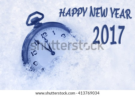 New Year 2017 greeting in English language, pocket watch in snow, happy new year 2017 text, 2017 new year concept - stock photo