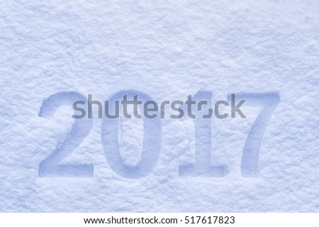 New Year 2017 greeting, 2017 numbers written on snow field, greeting card background