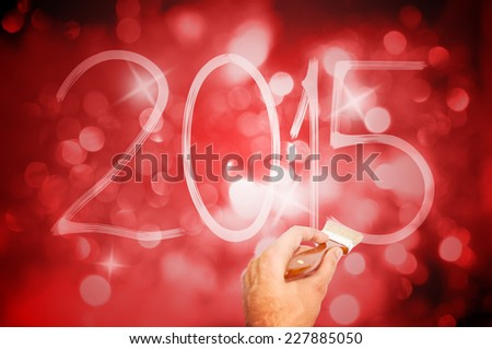 New year 2015 handwriting on the dark red background with bokeh effect - stock photo