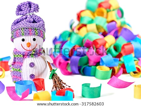 New Year 2016. Happy Snowman. Party decoration multicolored serpentine confetti. Cheerful fun winter holiday on white background, copyspace.Snowman celebration in festive hat, scarf smiling with broom