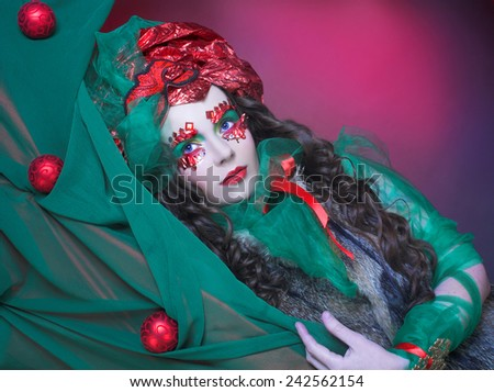 New Year image. Portrait of young woman in artistic holiday image. - stock photo