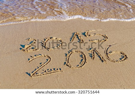 New Year 2016 is coming concept, Happy New Year 2016 replace 2015 concept on the sea beach