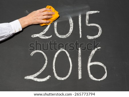 New Year 2016 is coming concept - inscription 2015 and 2016 written on a school blackboard, with the word figures 2015 being erased by the teacher.  - stock photo