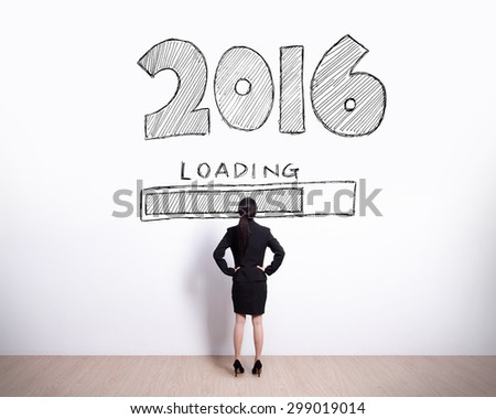 New Year is loading now - Back view of business woman look 2016 text on white wall background - stock photo