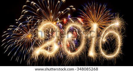 New Year - 2016 made a sparkler with fireworks - stock photo
