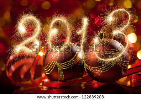 New Year 2013 made of real sparkles and Christmas spheres - stock photo