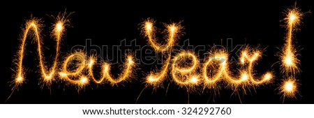 New Year made of sparkles on black background - stock photo