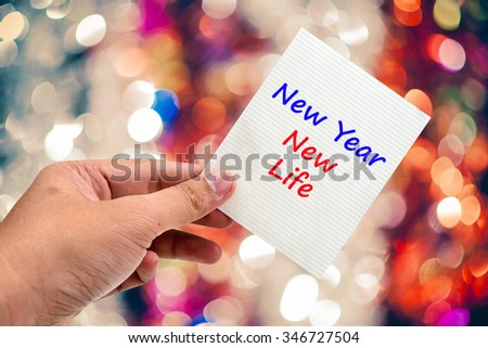 New Year New Life handwriting on a sticky note - stock photo