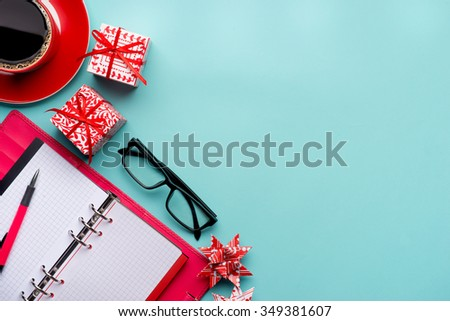 new year note and blank colorful paper notebook at office table, new year resolution concepts